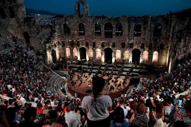 The Greek National Opera performing at the Herodus Atticus ancient theatre at the foot of the Acropolis last month(AFPGetty)